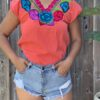 coral floral embroidered top closeup