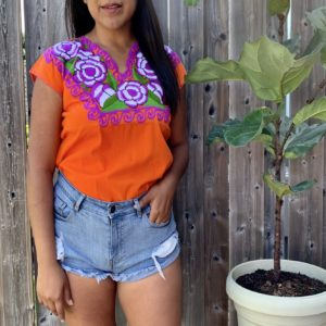 orange floral embroidered top by shilango