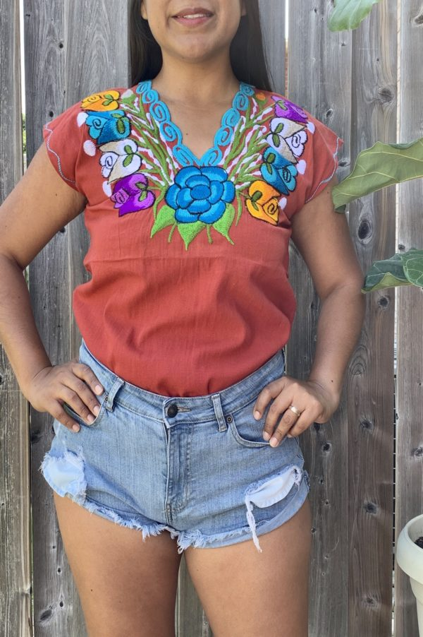 brown closeup floral embroidered top by shilango